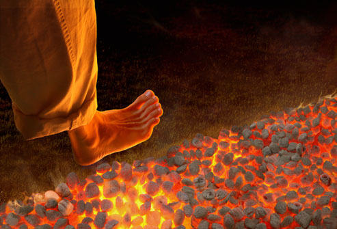 getty_rm_photo_of_man_walking_on_hot_coals