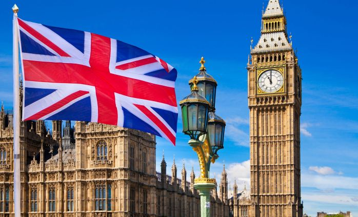 british-flag-big-ben-and-houses-of-parliament-royalty-free-image-616242056-1533662692